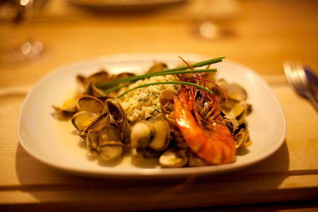 Citroenrisotto met groene kruiden en Zeeuwse kokkels en een jus van kokkels en witbier