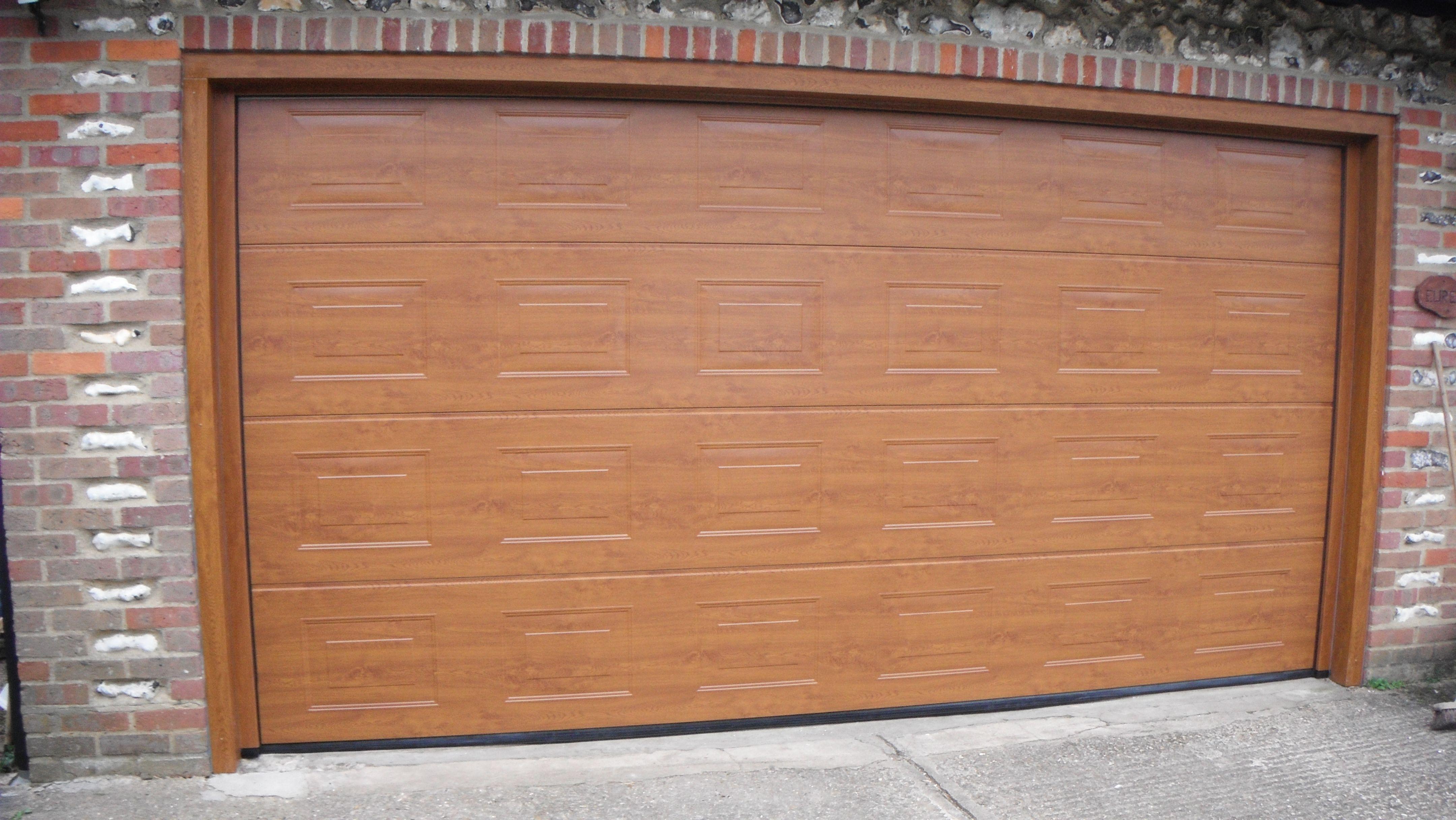 Doors and sidelights matching window on front and black onduline roof - Hormann Golden Oak S Panelled Decograin Sectional Garage Door