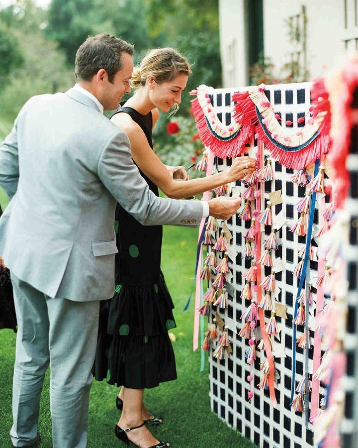 Colourful escort cards such a fun idea for summer wedding #summerwedding #escortcards #colourfulwedding