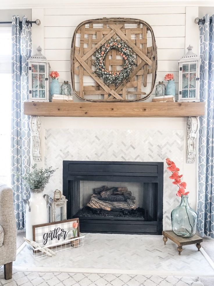 Photo of Spring fireplace decorating idea with aqua and coral accents! | Wilshire Collections