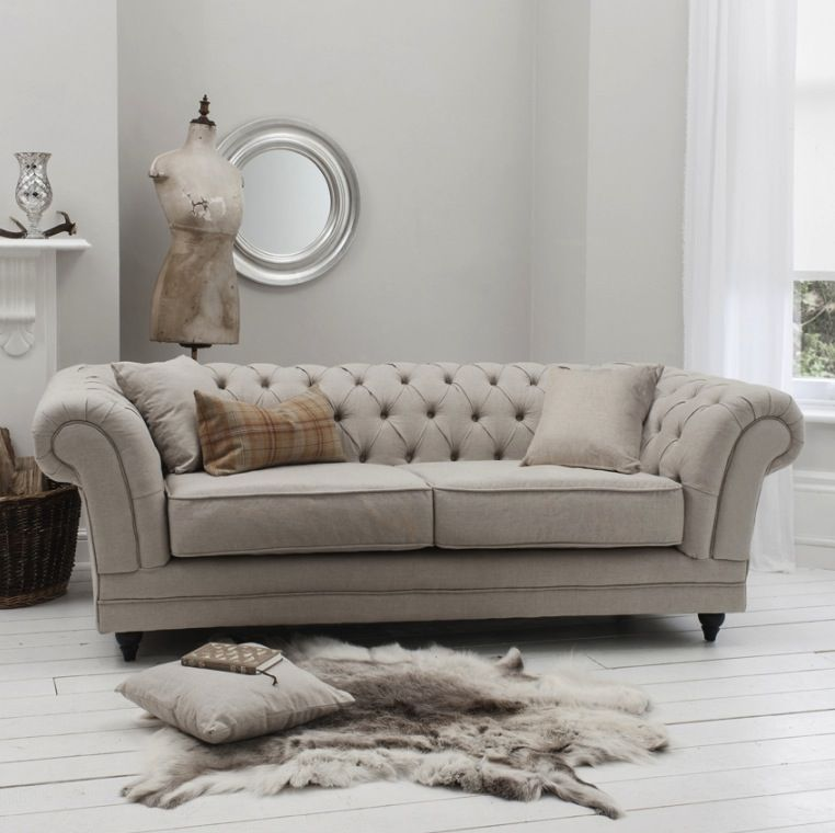 Furniture Inspiring White Theme In A Room Decorated With Chesterfield Sofa Accompanied Seat Cushions
