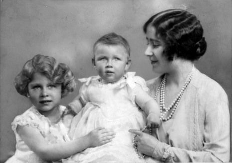 Queen Elizabeth, the Queen Mother while still Duchess of York with her 2 daughters, baby Princess Margaret (later Countess of Snowdon), and Princess Elizabeth, now Queen Elizabeth II.