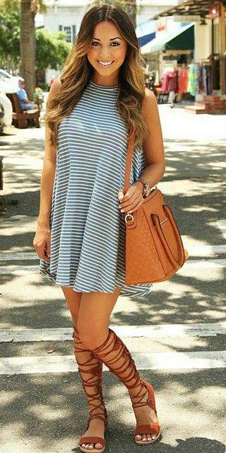 47c6d53e090 Pinkly smiling tanned brunette in sleeveless striped sundress   orange  gladiator sandals w  matching handbag