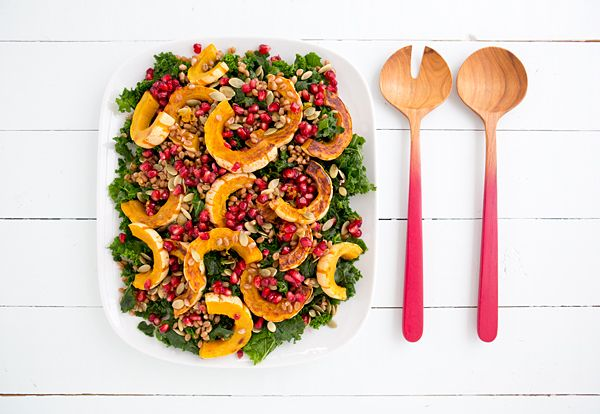 A bed of massaged kale topped with roasted delicata squash, pomegranate seeds, wheat berries, and pepitas, then drizzled with a Citrus-Maple Vinaigrette.