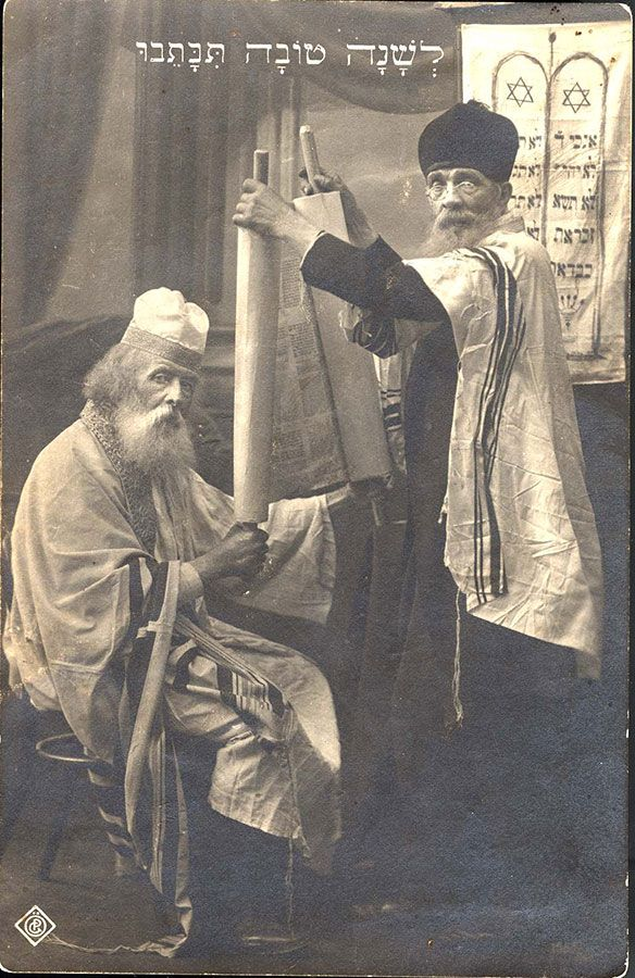 Two jewish men in the synagogue following the torah reading the two jewish men in the synagogue following the torah reading the hebrew greeting on top m4hsunfo