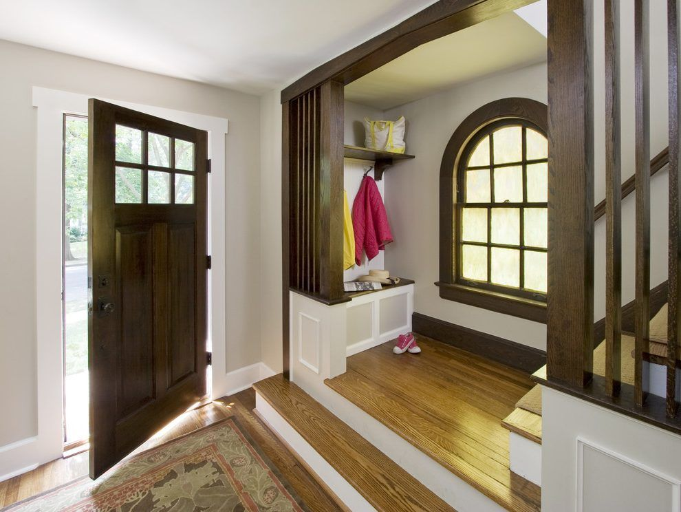 Dark Wood Trim And Doors Entry Craftsman With Wood Flooring Wood Molding White Wood Jpg 990 744 Dark Wood Trim Painting Wood Trim Rustic Doors