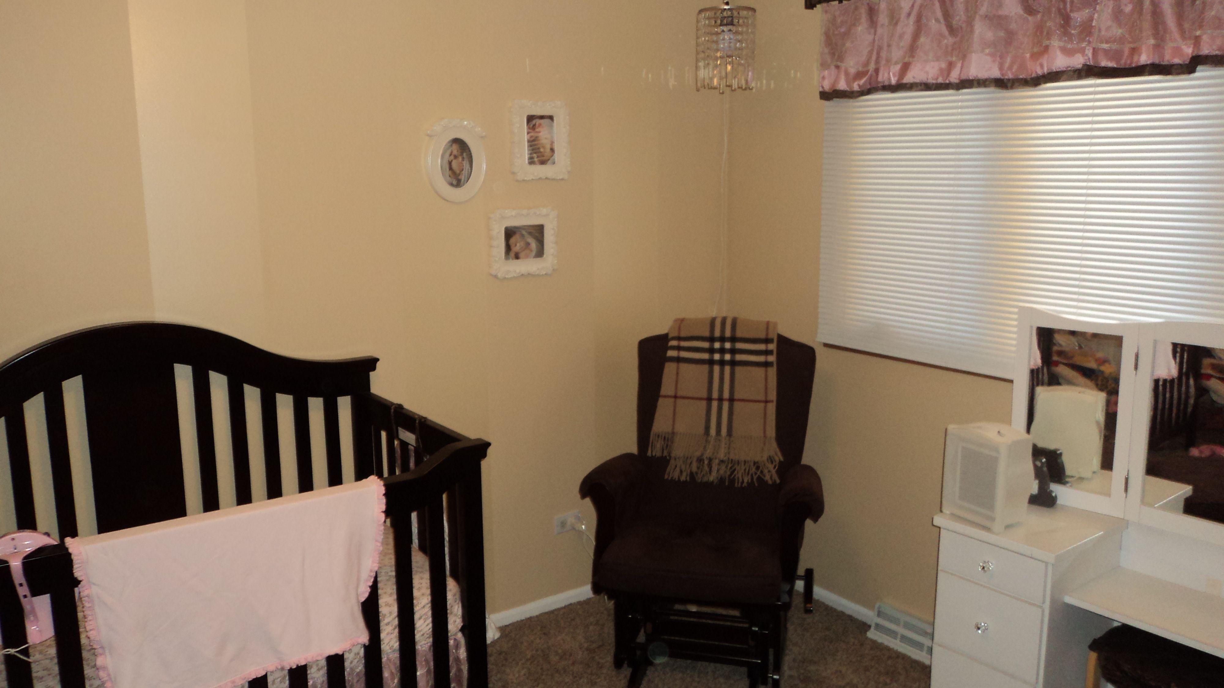 Nursery room. Burberry Throw. Crystal Chandelier.