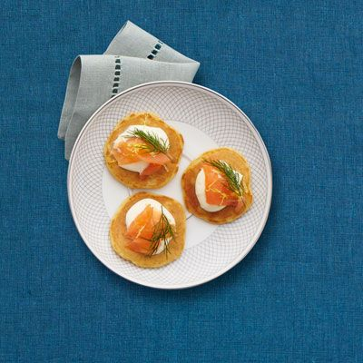 A classic Scandinavian-inspired party treat, these bite-size corn blinis topped with tangy sour cream and smoked salmon will satisfy all your holiday guests. Recipe: Smoked Salmon on Corn Blinis   - Delish.com