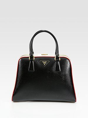 6694113938ceea Reminds me of an old school doctor's bag: Prada Saffiano Vernice Framed Top  Handle Bag