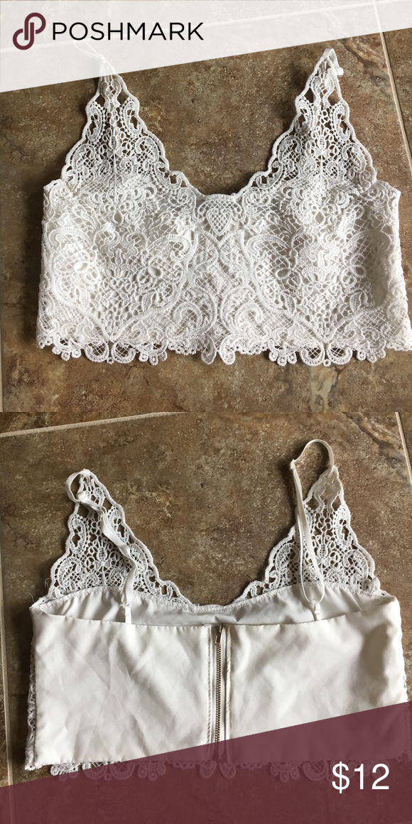Lace crop top - size Medium White Lace crop top is lined has adjustable straps and gold tone zipper in back.  Very cute in great condition Tops Crop Tops