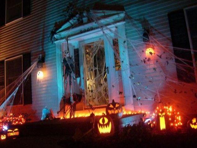 Spiderweb on your door - Spooky Ideas for Outdoor Halloween - outdoor halloween ideas