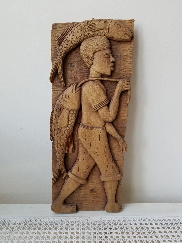 Vintage carved wood man fish fisherman wall art plaque primitive wood carving tribal folk art panel by vintagenowandthen on etsy
