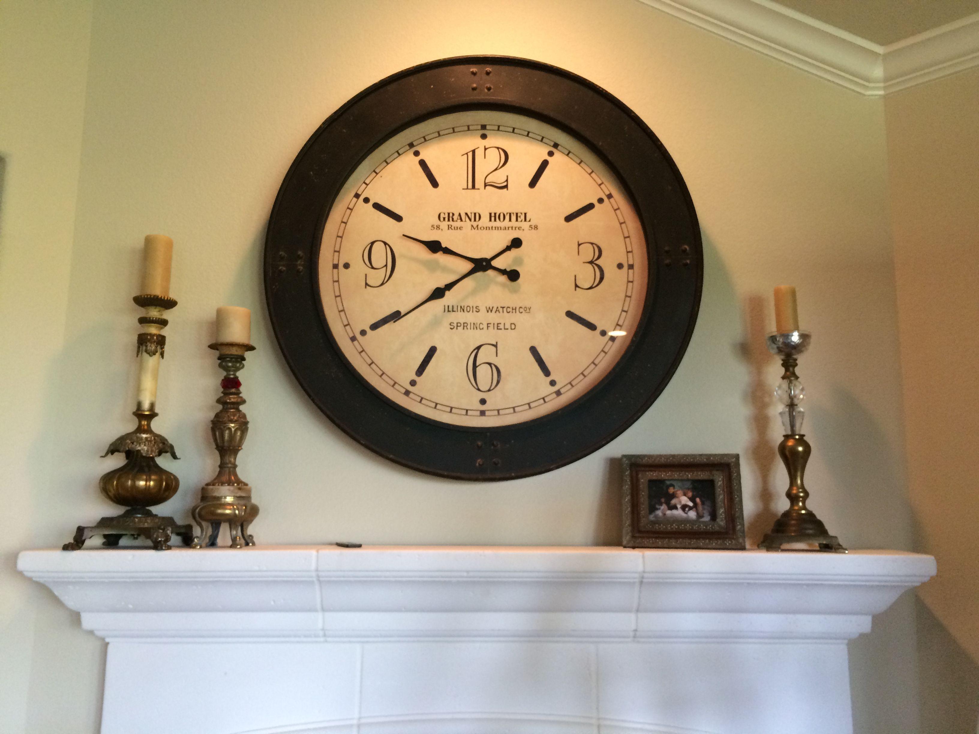 big clocks over a mantel are wonderful embellished cottage
