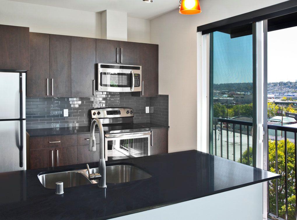 Model kitchen at AMLI Mark24, luxury Seattle apartments in Ballard ...
