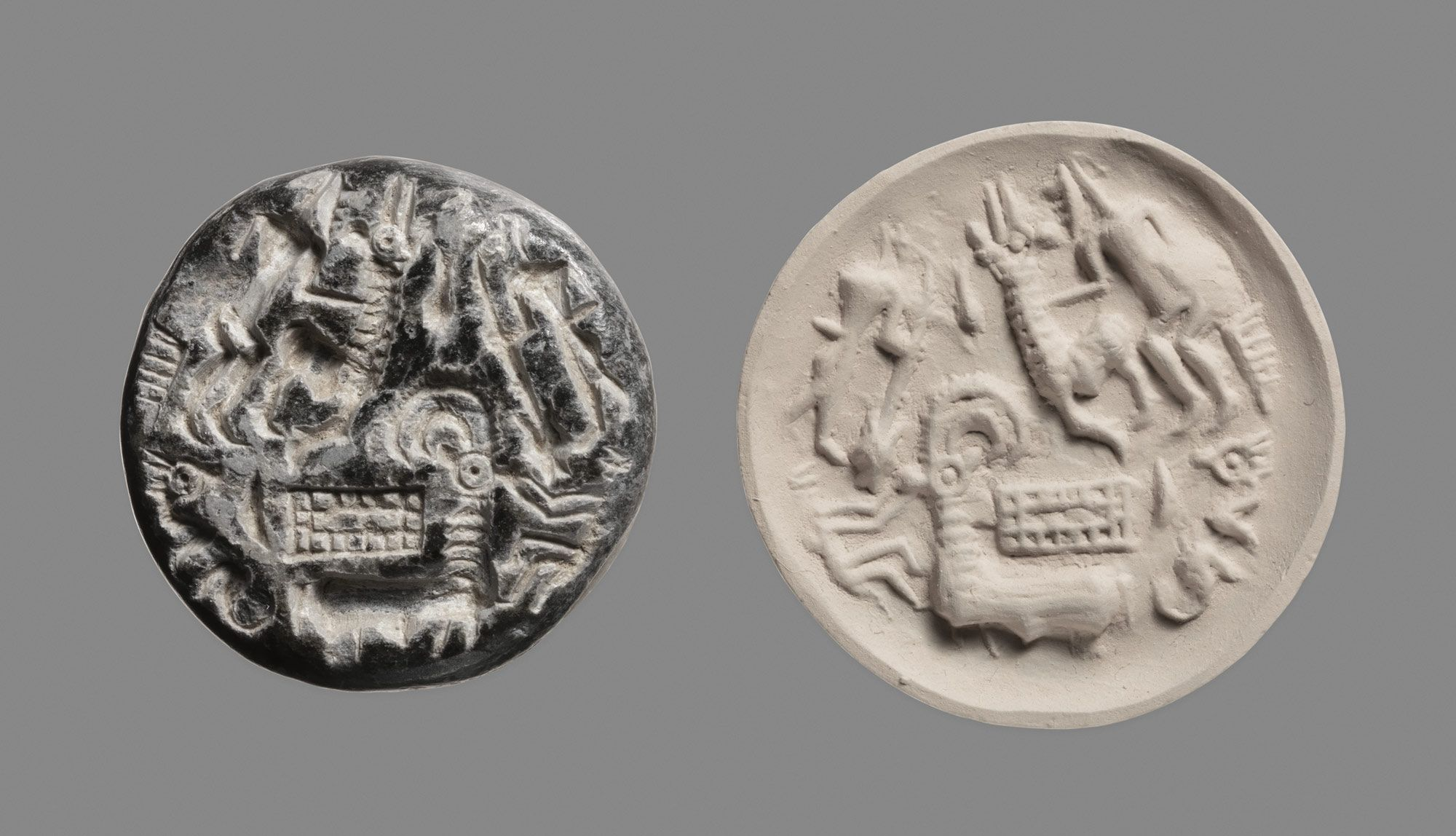 Stamp seal: hunters and goats, rectangular pen (?)  Period: Middle Bronze Age Date: ca. early 2nd millennium B.C. Geography: Dilmun Culture: Dilmun Medium: Steatite or chlorite Dimensions: 0.47 in. (1.19 cm)