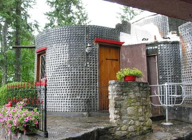 Eco Friendly Green Building with Used Empty Bottles | Green building on toothpick house designs, box house designs, wooden doll house designs, birdhouse house designs, glass house designs, playing card house designs, miniature house designs, pump house designs, boxcar house designs, tube house designs,
