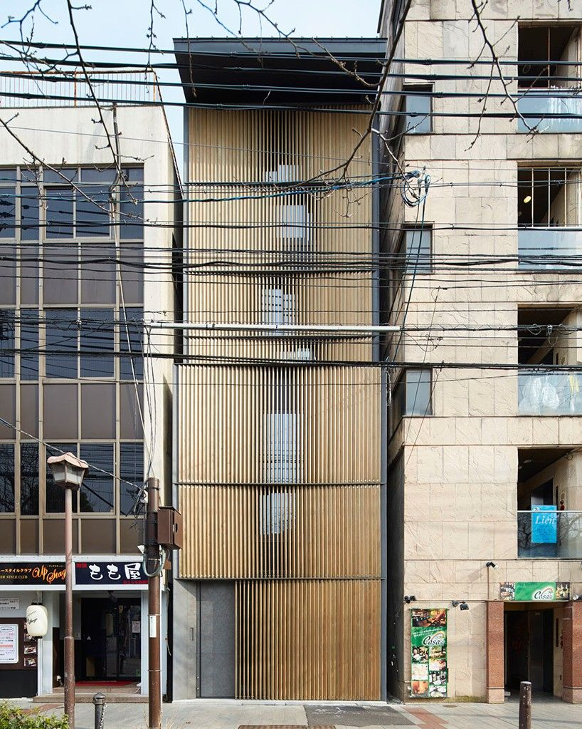 florian busch disguises eight storey nightlife venue in kyoto with