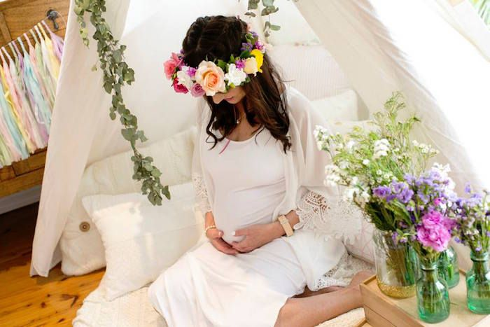 86ae5c5301 Flower crown and floral arrangements from Boho Chic Baby Shower via Kara s  Party Ideas