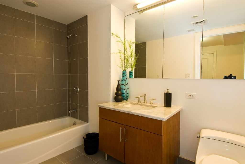 pictures of bathrooms with small black and white tile floors bath