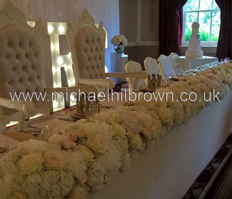 Opulent Wedding Reception Top Table Flower Arrangement By Michael Hilbrown Flowers Used Hydrangea