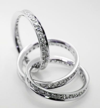 Eternity ring just add one more band with pink diamonds A band