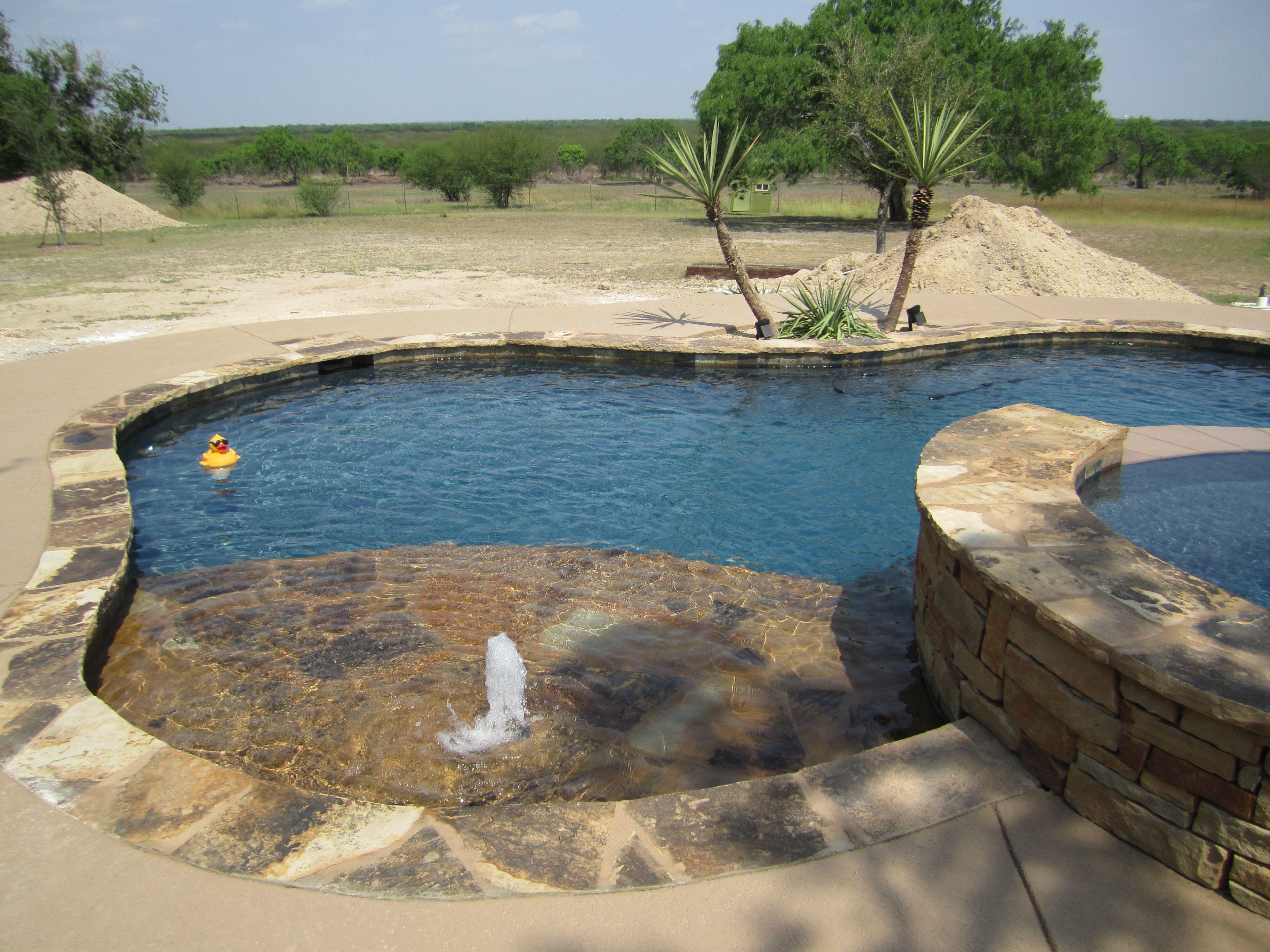 Oklahoma wister flagstone coping and cap on sunshelf for Pool design okc