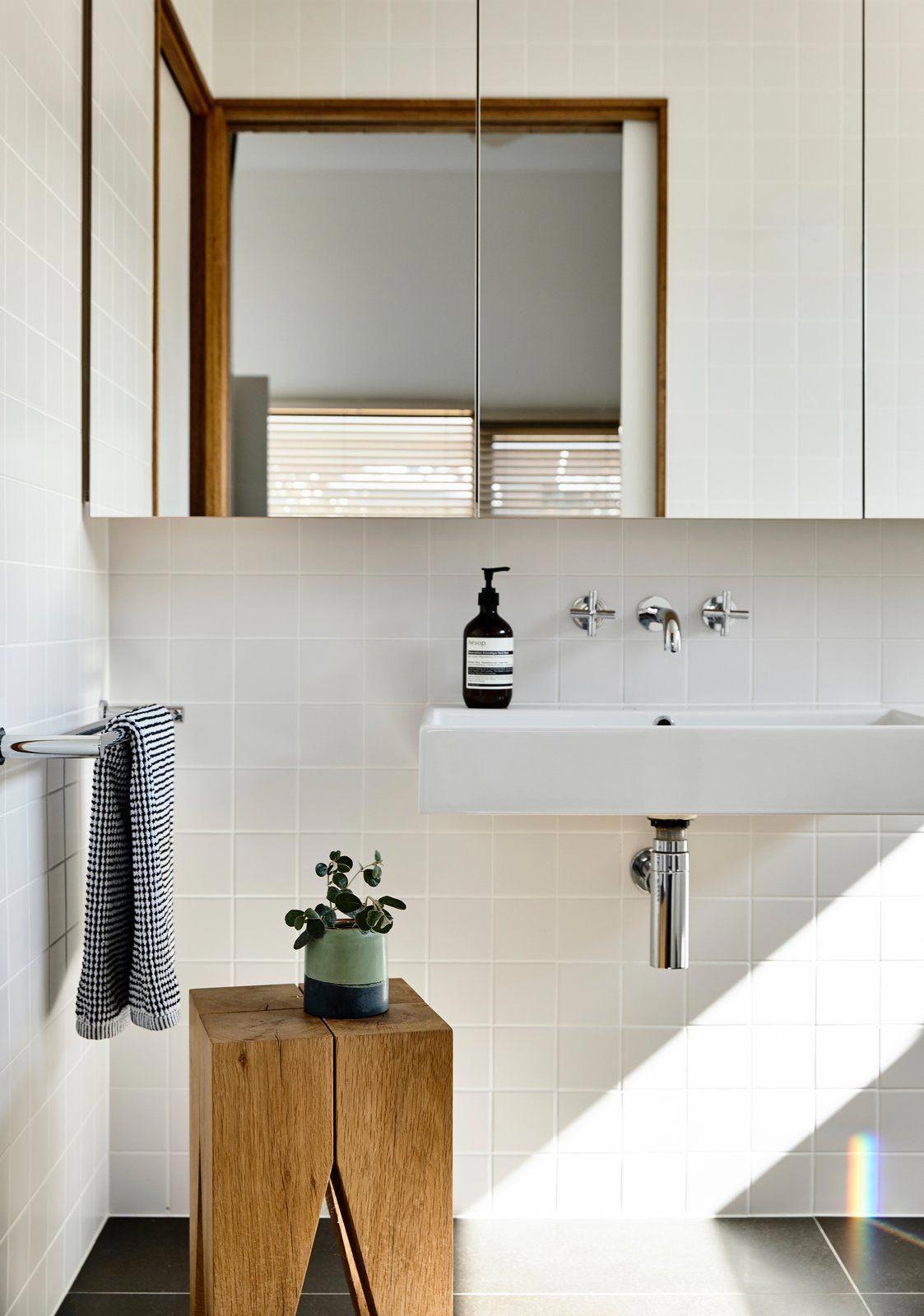 bath room slate floor wall mount sink and ceramic tile