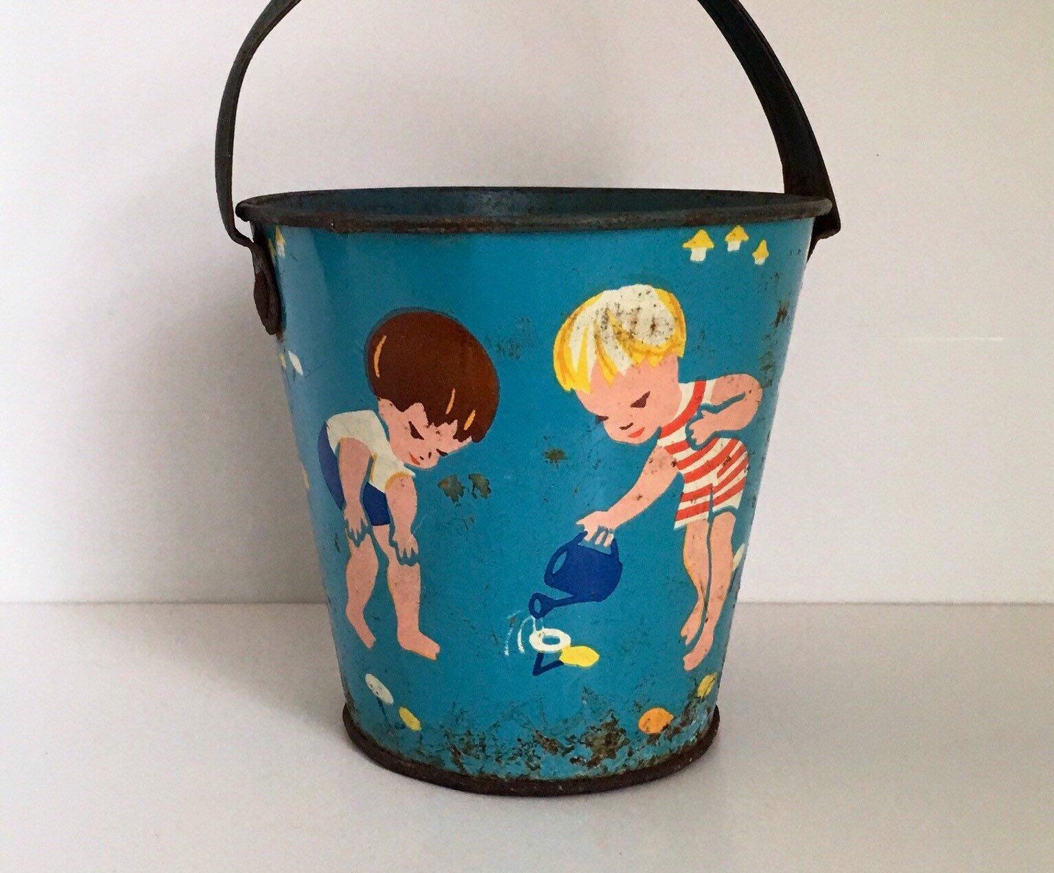 Vintage Tin Sand Bucket Blue Metal Pail Children And Flowers Shabby Chic Vintage Toy Etsy Toys Blue Birthday Ind Vintage Tins Vintage Toys Vintage Tin