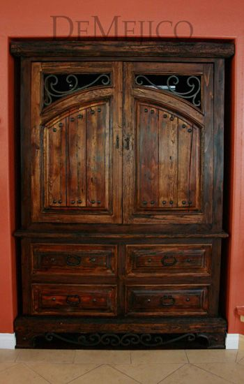 Custom spanish style furniture Tooled Leather This Custom Spanish Entertainment Center Is Made From Old Wood And Is Accented By Intricate Hand Forged Iron Designs And Hardware Cheeky Beagle Studios This Custom Spanish Entertainment Center Is Made From Old Wood And