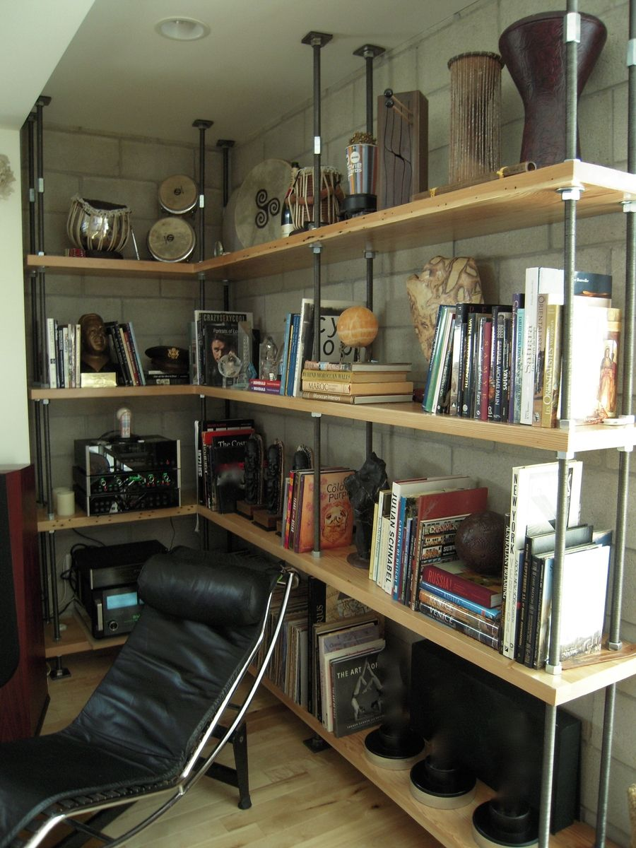 Custom made builtin metal and reclaimed wood bookcase by mortise
