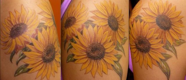 Photo of Sunflower tattoo. i want this on my lower right side of my back. kind of inching…