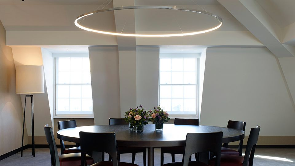 Nulty global trading house london office meeting room halo circular light fixture classic interior