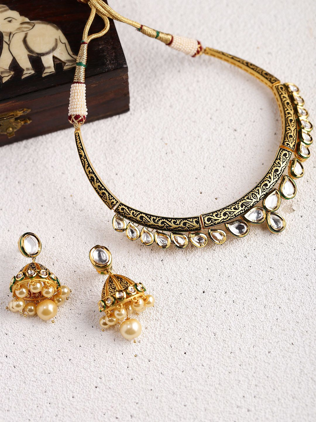 Dhruvi by zaveri pearls antique goldtoned embellished jewellery set