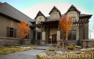 A mix of stone brick timbers and stucco bearspaw for Mixing brick and stone exterior