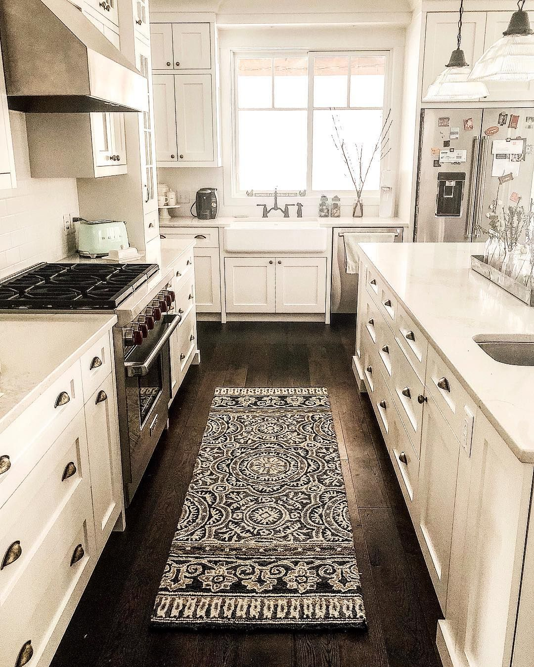 Neutral Kitchen With Copper Farmhouse Sink And Vintage Oushak Rug
