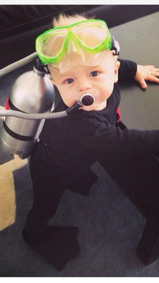 easy diy baby scuba diver halloween costume that uses a soda bottle as an air tank pool swimming goggles and pacifier for mouthpiece