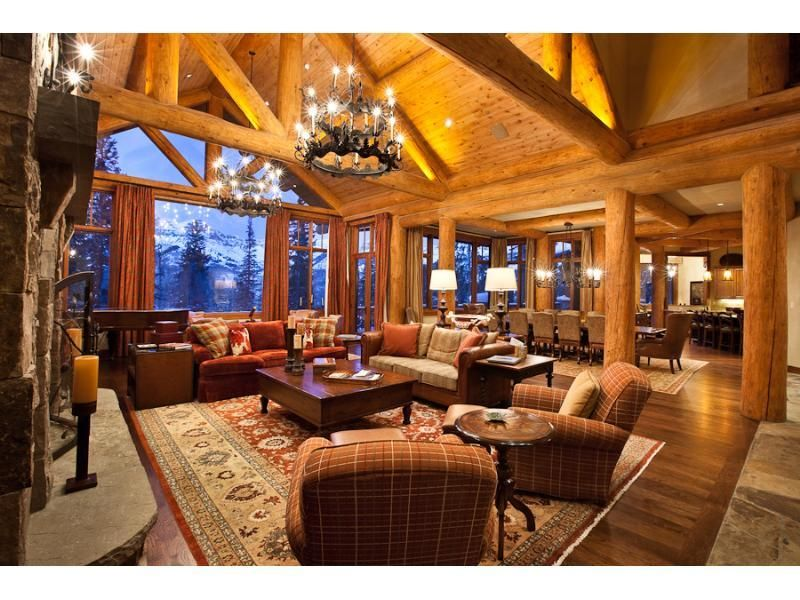 After A Long Day Of Hitting The Slopes Guests Will Gladly Sit Back And Relax In This Warm And Inviting Living Room Soaring Ceilings Glittering