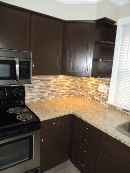 Flipping Houses  Before and After Pictures  The Stone Head The Kitchen Renovation Mosaic Tile Backsplash General Finishes Gel Stain in Antique Walnut Stainless steel Frid...