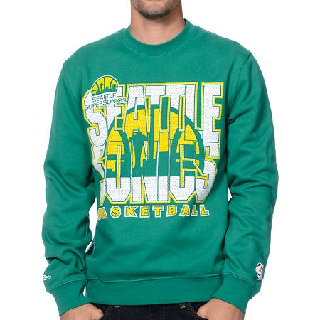 5f3387a2be7 Even though they are gone you can still show your pride for the Sonics with  the NBA Mitchell and Ness Seattle Sonics Tech Foul green crew neck  sweatshirt.