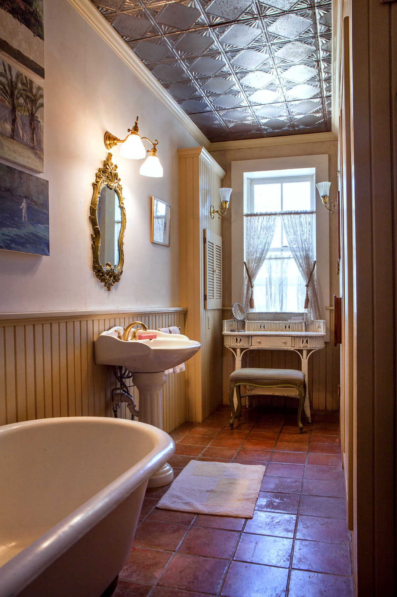 A bathroom in an 1878 adobe home in New Mexico has a claw