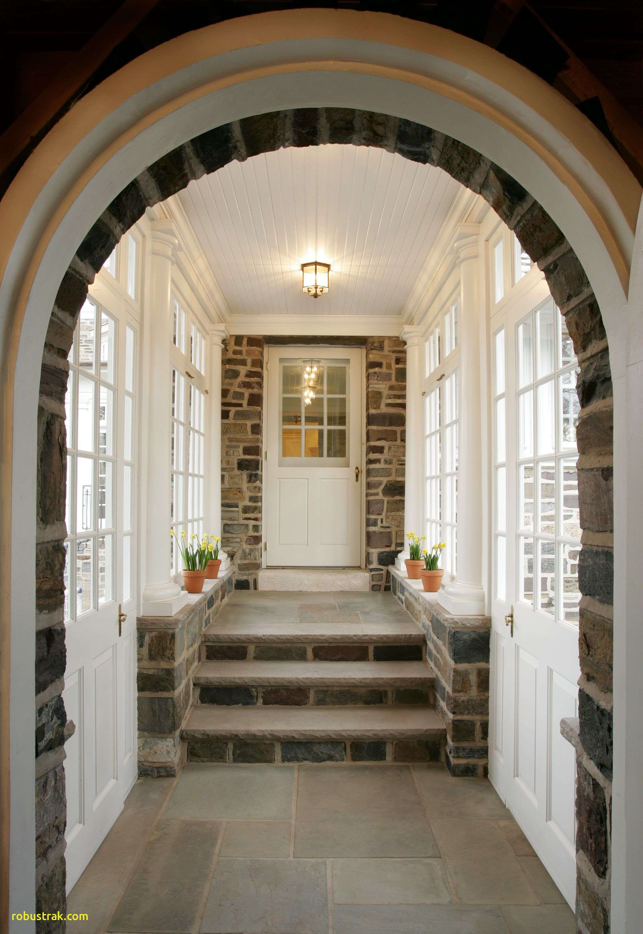 Enclosed Breezeway The Stone Archway Frames The Entrance Into The Breezeway From The Garage Tuscan Columns Clerestory Glass Princeton Houses Breezeway House