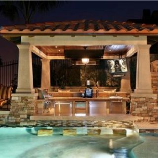 Outdoor kitchen with a swim up bar u can sit down in the for Pool design swim up bar