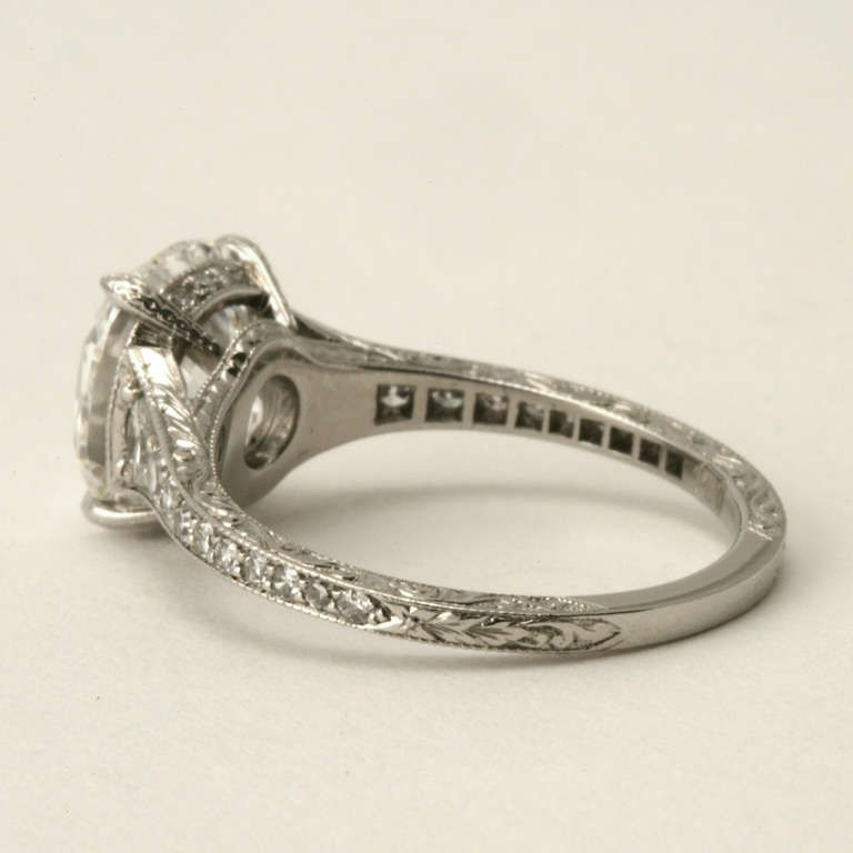 Art Deco Style Cushion-Cut Diamond Ring Set in Platinum with Diamond Accents | From a unique collection of vintage engagement rings at http://www.1stdibs.com/jewelry/rings/engagement-rings/