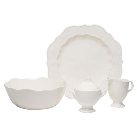 Set an elegant table with this crisp white serveware, featuring scalloped edges for a sophisticated look.  Product: Plat...