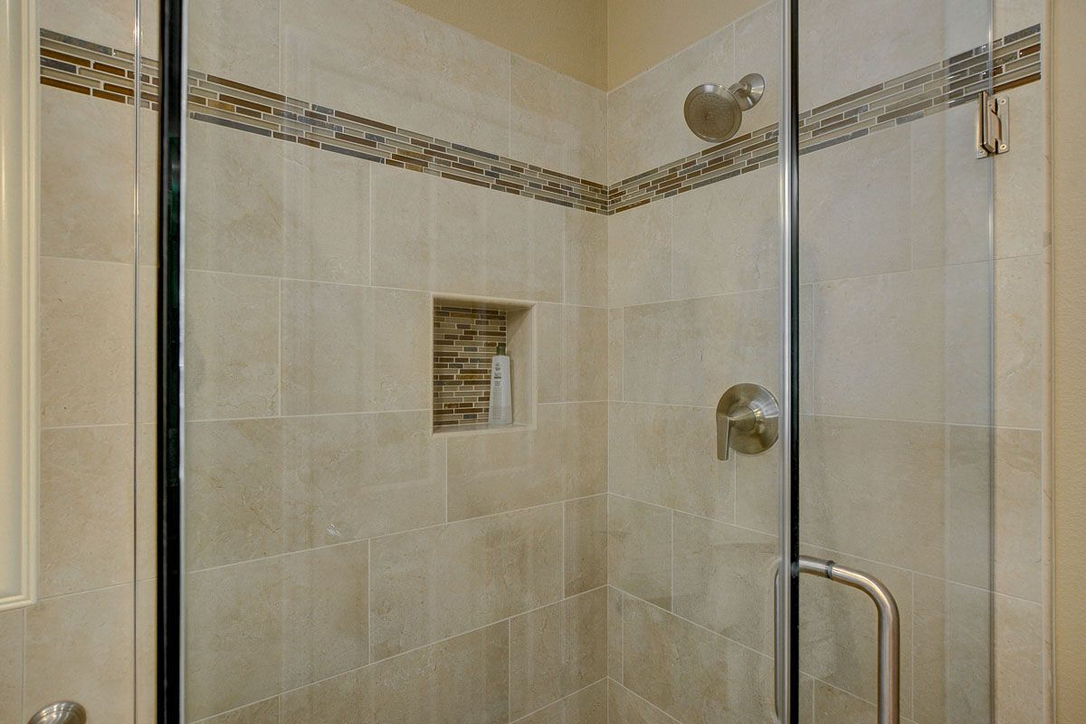 Tan bathroom wall tile ideas by our Las Vegas Remodel and ...