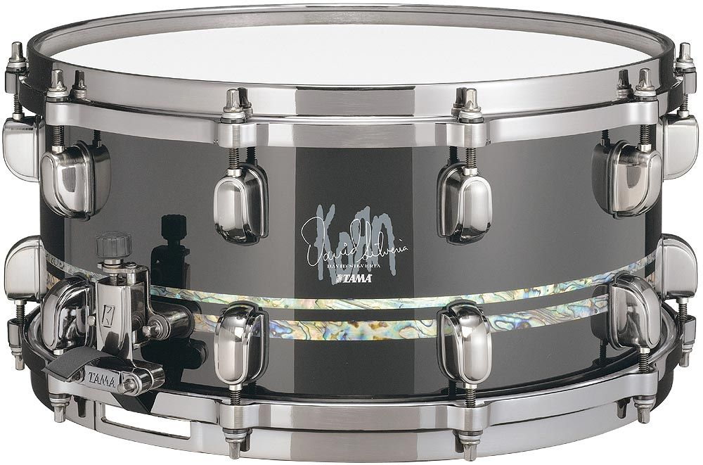 """David Silveria (Korn) Signature Size: 6.5""""x 14"""" Material: 13ply 10mm G-Maple Shell Finish: Piano Black Double Abalone Inlays (10mm & 5mm) Hardware Finish: Brushed Black Nickel Lugs: MSL-SCT in Brushed Black Nickel Strainer: MUS80A in Brushed Black Nickel Butt: MUS80B in Brushed Black Nickel Snappy: MS20SN14S Hoop: Die-Cast Batter Head: REMO Ambassador Coated Bottom Head: REMO Snare Side"""