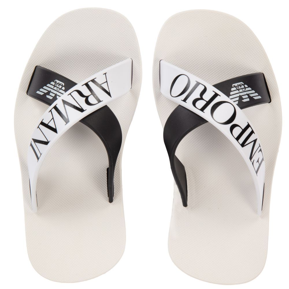 103d2ce92 Boys white and black PVC sliders from luxury brand