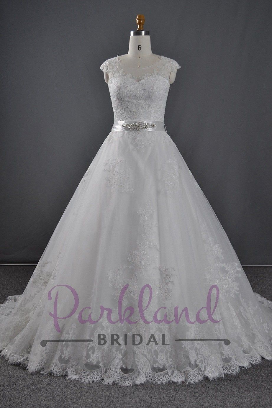 A beautiful Tulle A-line gown embellished with gorgeous lace with a sheer neckline. Features a stunning luxury beaded sash at the waist.  http://www.parklandbridal.co.nz/Store/tabid/4393/ProdID/34768/CatID/358/Parkland_Bridal_Adine.aspx
