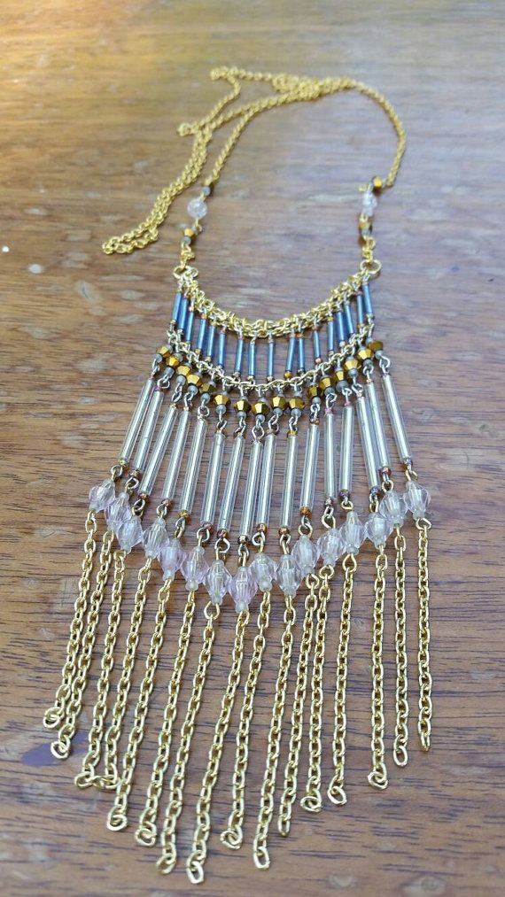 Check out this item in my Etsy shop https://www.etsy.com/listing/459881650/extra-long-chain-tassel-necklace