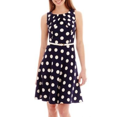 Classic Polka Dots And Traditional Sheath Styling Ensure